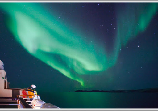 Travel on the Hurtigruten expedition ship Nordlys to see the amazing sky show of the Northern Lights. This aurora was seen over Lofoten, Norway.