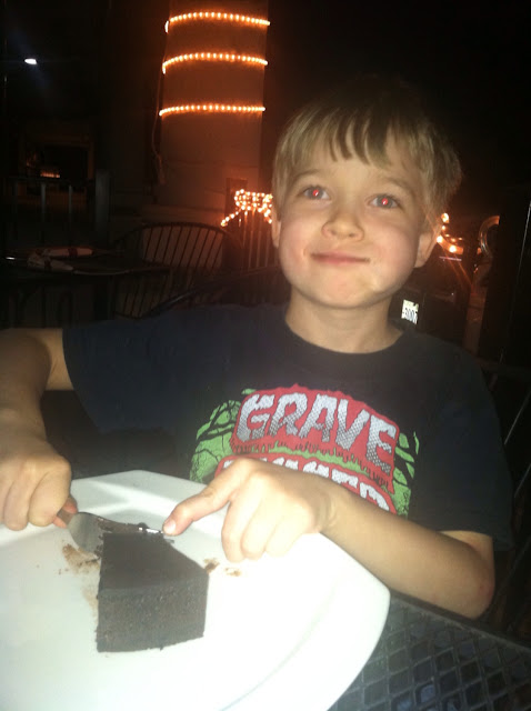 Nathaniel happily eating his flour less chocolate cake!