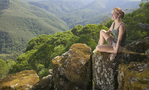 Thunderbolts_Lookout_Barrington_Tops_NSW - A woman looks out over Thunderbolts Lookout in Barrington Tops National Park, Hunter, New South Wales, Australia.