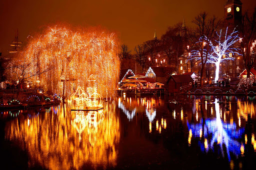 Christmas-Tivoli-Lake-Copenhagen - Christmastime in Copenhagen's Tivoli Lake, part of Tivoli Gardens, which opened in 1843, making it the second oldest amusement park in the world.