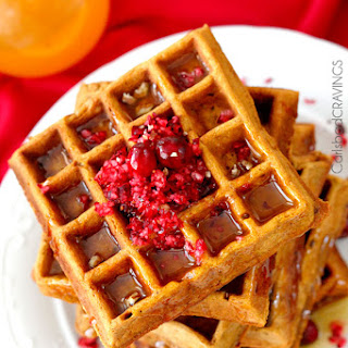 Cranberry Pecan Gingerbread Waffles with Orange Syrup.