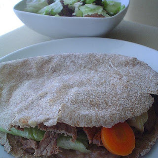 Grilled Beef and Marinated Vegetable Pita Pockets.