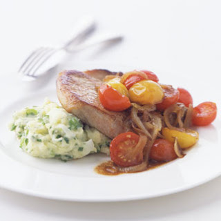 Pork Chops with Golden Onions and Wilted Tomatoes.