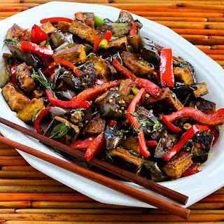 Sriracha-Spiced Stir-Fried Tofu with Eggplant, Red Bell Pepper, and Thai Basil.