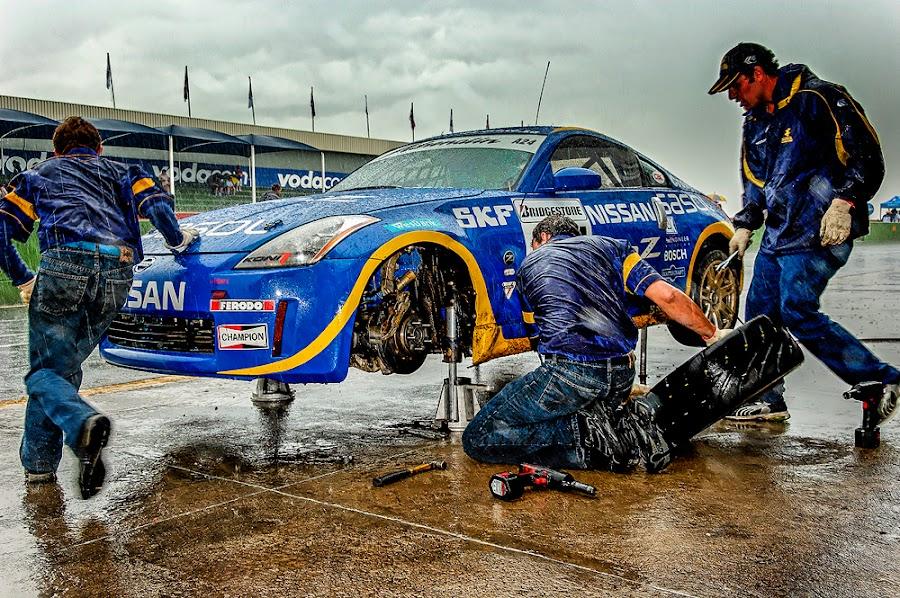 Emergency pit stop by Peter Primich - Sports & Fitness Motorsports ( nissan 350z, panic, racing, kyalami, proffessional, rain, mechanic )