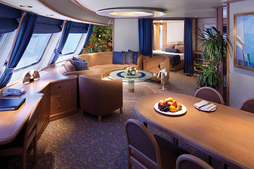 The Owners Suites on board Seabourn Spirit offer an elegant experience, with a separate bedroom, a private and guest bathroom, a semicircular couch, ocean views, private veranda, fully stocked bar and dining area.