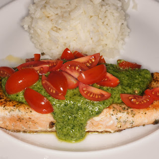 Herb Crusted Salmon with Arugula Citrus Pistou and Grape Tomatoes.