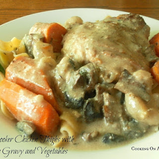 Slow Cooker Chicken Thighs with Creamy Gravy and Vegetables