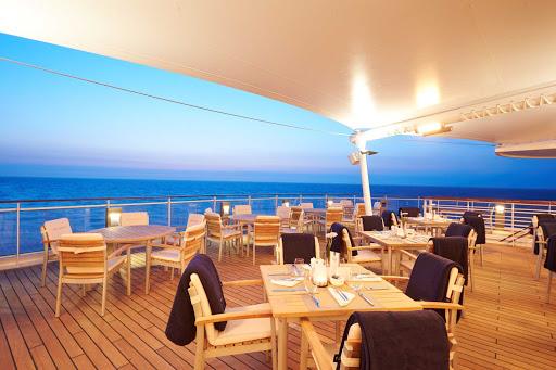 Europa-2-Yacht-Club-terrace - Enjoy the ocean views and salty sea breeze from the Yacht Club terrace aboard Europa 2.