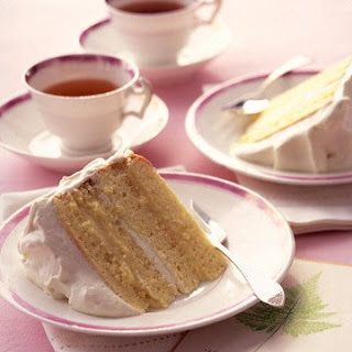 Genoise Layer Cake with Rum Syrup and Whipped Cream Frosting.