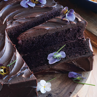 Giant Chocolate Cake with Bittersweet Chocolate Ganache and Edible Flowers.