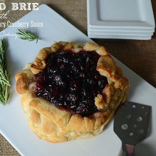 Baked Brie with Balsamic Rosemary Cranberry Sauce.