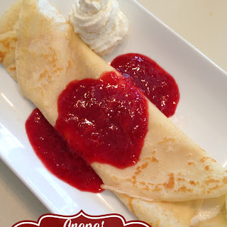 Crepes with Whipped Orange Ricotta & Fresh Strawberry Sauce.