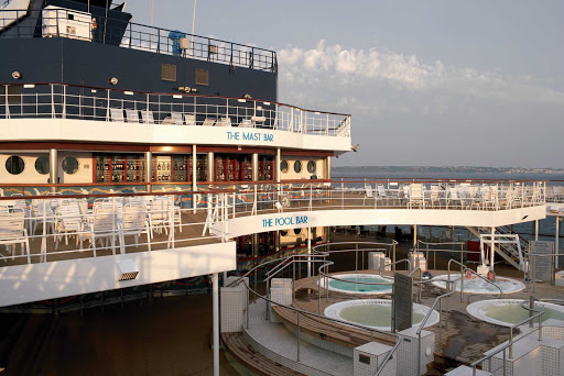 Savor the moments in the whirlpools on Celebrity Century's pool deck.