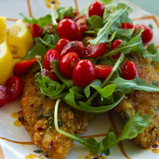 Breaded Chicken Cutlets With Tomatoes and Arugula.