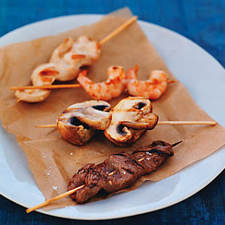 Grilled Beef, Chicken, Shrimp, and Mushroom Skewers.