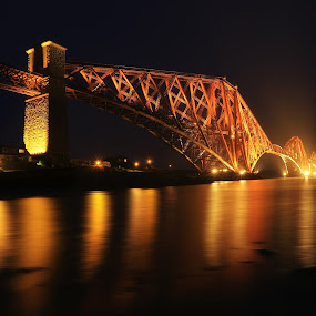 The Forth Rail Bridge crossing between Fife and Edinburgh by Naďa Murmakova - Buildings & Architecture Bridges & Suspended Structures ( forth, vertical, old, firth, travel, architecture, of, ancient, sky, train, structure, estuary, colors, tourism, fife, landmark, edinburgh, railway, bridge, view, scotland, famous, crossing, reflection, colorful, queensferry, road, landscape, engineering, coast, iron, lights, transport, rail, construction, water, clouds, uk, scottish, sea, scenic, steel, urban, red, sunset, victorian, summer, sunrise, river, britain,  )