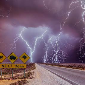 Highway massacre by Craig Eccles - Landscapes Weather ( thunder, sign, lightning storm, lightning, desert, highway, cloud, thunderstorm., thunder storm, road, storms, storm,  )