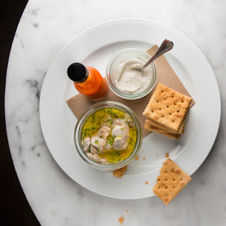 Smoked Oysters with Crème Fraîche and Saltines