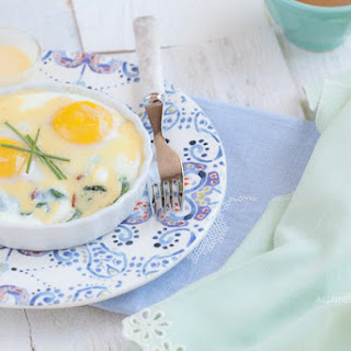 Baked Eggs with Bacon, Greens,and Hollandaise