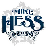 Logo of Mike Hess Ficus Fig Saison With Rum Soaked Oak And Orange Swirl
