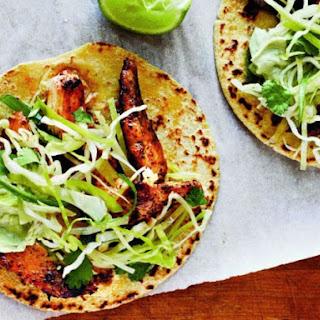 Cooking Light's Ancho Chicken Tacos with Cilantro Slaw and Avocado Cream.
