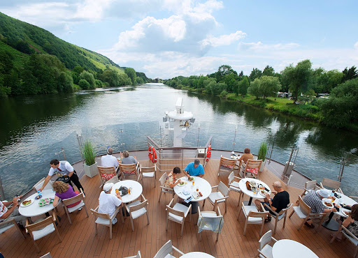 Viking-River-Cruises-Aquavit-Dining-Terrace-on-deck - Any seat in the Aquavit Terrace offers a front-row seat to spectacular views along Europe's waterways on your Viking River Cruise.