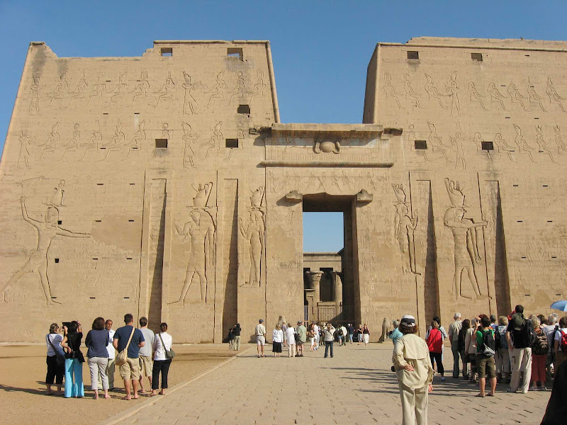 Edfu, Egypt, located on the west bank of the Nile. The town is known for the Temple of Horus, built from sandstone blocks between 237 BC and 57 BC, into the reign of Cleopatra VII, Wikipedia tells us.