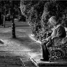 by Dave Angood - Black & White Portraits & People ( sitting, bench, london, seat, steps, sunlight )