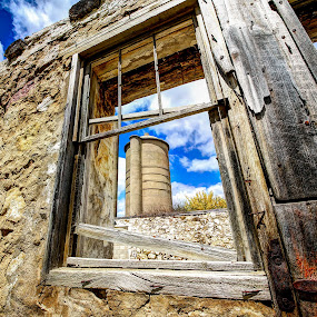 Through the window by Anna-Lee Nemchek Cappaert - Buildings & Architecture Decaying & Abandoned ( field, window, barn, sunny day, field stone, silo, abandoned, farm structures )