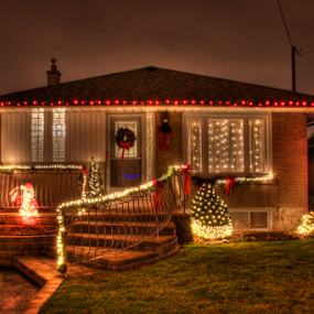 Home decorated for Chritsmas by Toronto-Images .Com - Public Holidays Christmas ( festive, home, detail, christian, christianity, exterior, object, house, city, lights, yelo34, kwanzaa, tradition, decorated, artifical, celebrate, black, decoration, colors, green, beautiful, christmas, mood, traditional, holiday, urban, hanukkah, red, lighting, blue, tis the season, night, celebration, mood factory )
