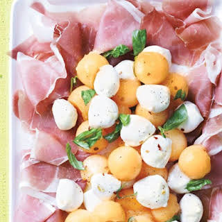 Cantaloupe and Mozzarella with Prosciutto and Basil.