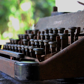 Sunning itself at this old age... by Anoop Namboothiri - Artistic Objects Antiques ( old, hermes, typewriter, rusted, key board, from the attic, antique, letters, key pad, , vertical lines, pwc )