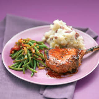Glazed Pork Chops with Smashed Potatoes and Stewed Green Beans.