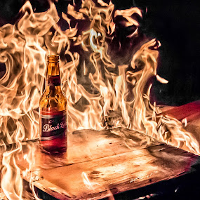 A hot beer on a cold day by Wahan Shahbazian - Artistic Objects Other Objects ( chair, flames, beer, wood, camping, south africa, barbeque, bottle, fire )