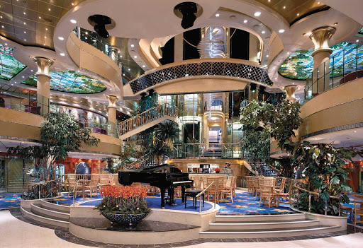 Norwegian-Dawn-Atrium - The atrium on Norwegian Dawn conveys a festive atmosphere and is a great place to hang out while enjoying live piano music.