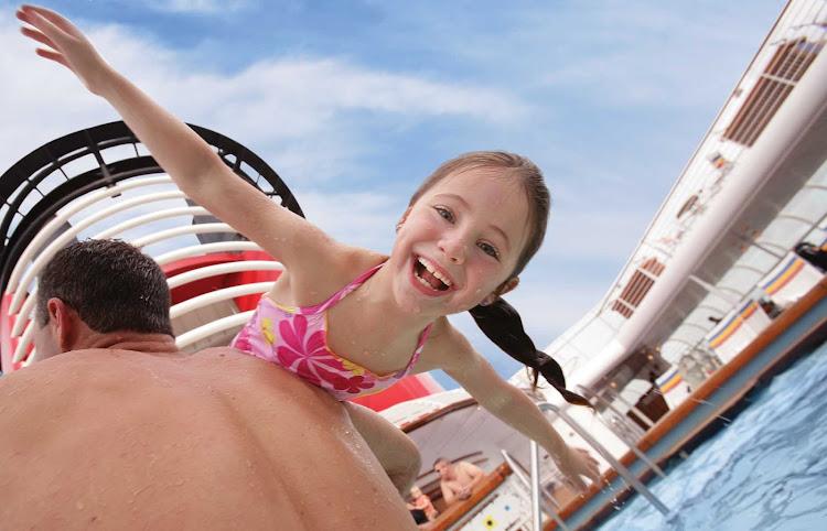 Having fun in the Family Pool on deck 5 of sister ships Disney Magic and Disney Wonder.