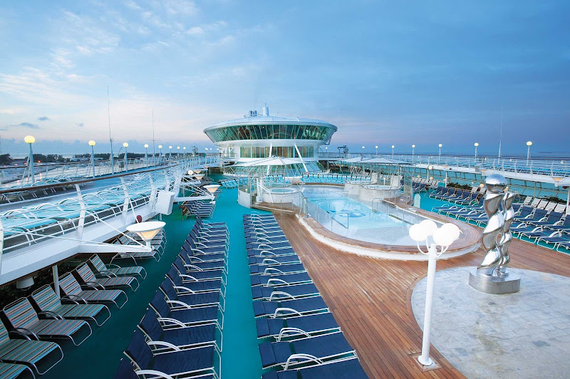 Relax, swim and soak in the rays in the adults-only Solarium aboard Enchantment of the Seas.