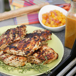 Grilled Jerk Chicken with Scotch Bonnet Sauce and Mango Chutney.