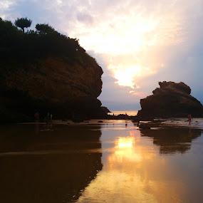Sunset on the beach by Alexandra Rafaila - Landscapes Sunsets & Sunrises ( sand, orange, sea, rock, ocean, beach, people, holiday, sky, sunset, summer, night, france,  )