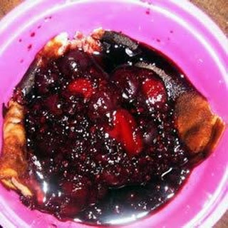 Skillet Custard with Berry Sauce