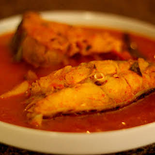 Meen Kuzhambu   Fish Curry in Tamarind and Coconut Sauce.