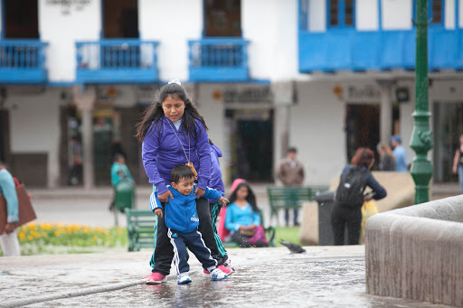 Kids playing at Cusco plaza-2 - Local kids goofing around at the foundation in Plaza de Armas, Cusco.