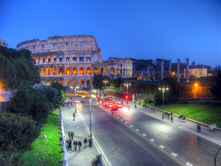 A color-enhanced view of the Colosseum in Rome at dusk.