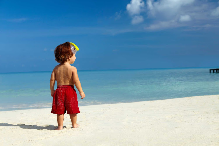 A beach on Aruba with a very young visitor.