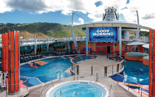 Freedom-of-the-Seas-pool-deck-island - Choose your swim — or soak — from one of Freedom of the Seas' 10 swimming pools and whirlpools.