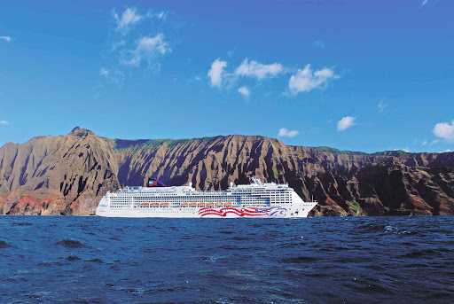 Norwegian-Pride-Of-America-Napali-Coast-1 - Cruise to Kauai, Hawaii, and experience the beauty of Na Pali Coast's green cliffs and splendid waterfalls.