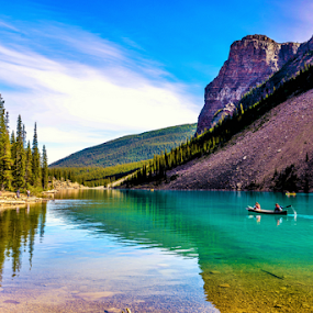Maraine Lake by Joseph Law - Landscapes Waterscapes ( in banff national park, blue sky, rocky mountains, trees, reflections, maraine lake, boat, rocks,  )