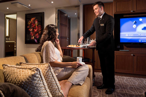 Savor the high tea served by your butler in Celebrity Silhouette's Royal Suite.