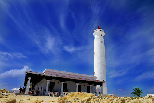 The Celarain lighthouse (Faro de Celarain) sits on the promontory of Punta Sur in southern Cozumel. It's part of an eco-park that includes reefs, lagoons, beaches and low forest.